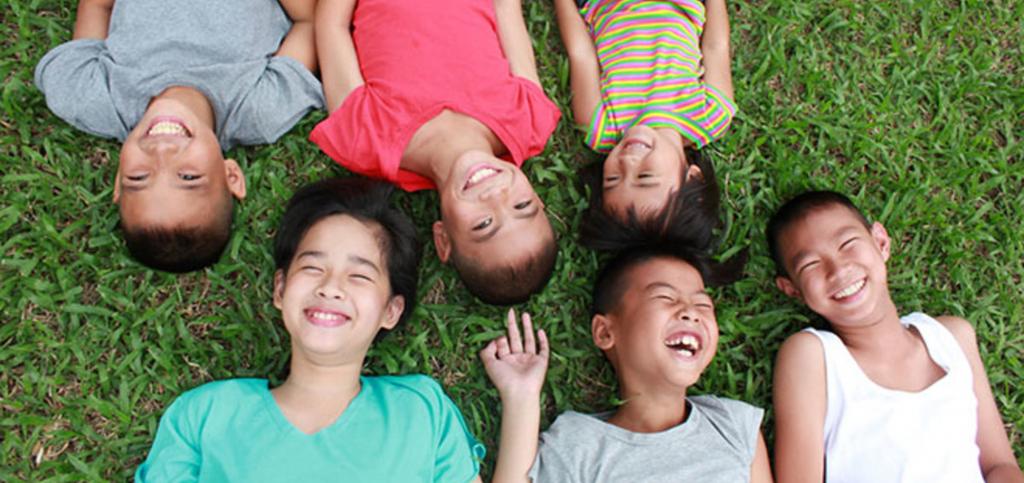 kids smiling on floor